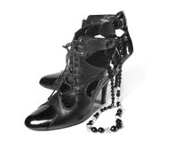 Pair of female classic shoes with necklace Royalty Free Stock Photo
