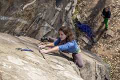 Pair of female climbers assault the rock wall Stock Photos