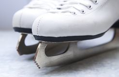 Pair of female figure white skates royalty free stock photography