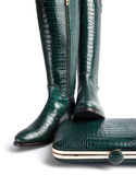 A pair of female green leather boots, and a handbag Stock Image