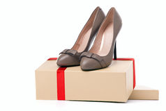 Pair of female high-heeled shoes on box. Over white background Stock Image