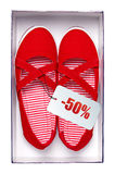 Pair of female red shoes with discount tag in box Royalty Free Stock Image