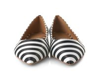 Pair of female shoes on background. Pair of female shoes on white background stock images