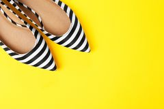 Pair of female shoes on color background. Top view royalty free stock photography