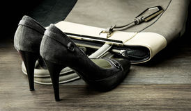 Pair of female shoes and handbag isolated on a dark Stock Photography