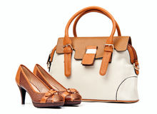 Pair of female shoes and handbag over white Royalty Free Stock Images