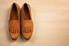 Pair of female shoes. On wooden background stock images