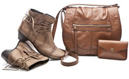 Pair of female shoes and handbag over white Stock Images