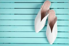 Pair of female shoes on wooden background. Top view royalty free stock photography
