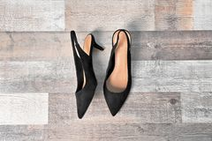 Pair of female shoes on wooden background. Top view stock images