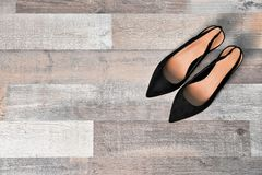 Pair of female shoes on wooden background. Top view stock image