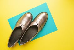 Pair of female shoes on yellow background stock image