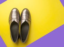 Pair of female shoes on yellow background. royalty free stock images