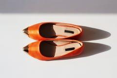 Pair of female summer shoe.orange girls shoes Royalty Free Stock Images