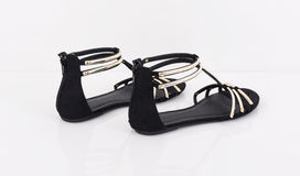 Pair of female summer tape black sandals Royalty Free Stock Photos