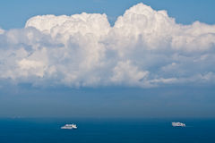 A pair of ferry ships in the sea Royalty Free Stock Images