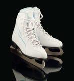 Pair of figure ice skates. Ice skates isolated on a black background Royalty Free Stock Photos