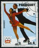 Pair figure skating at Winter Olympics at Innsbruck. RUSSIA KALININGRAD, 19 APRIL 2017: stamp printed by Paraguay, shows  pair figure skating at Winter Olympics Royalty Free Stock Photos