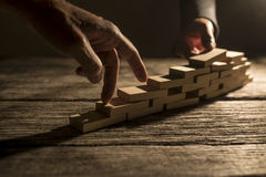 Pair of fingers walking up wooden blocks Stock Photos