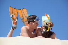 Pair in fins and underwater masks Stock Photo