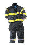 A pair of firefighter pants and suit on white background Stock Photography