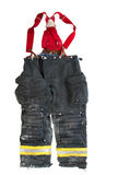 A pair of firefighter pants on white background Royalty Free Stock Image