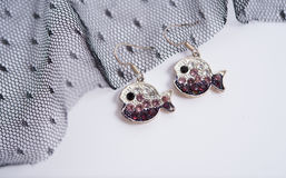 a pair of fish earings Royalty Free Stock Image