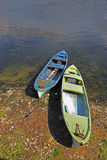Pair of fishing boats near lake with vertical composition Royalty Free Stock Photography