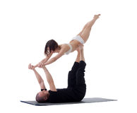 Pair of flexible athletes doing yoga exercises Stock Images