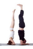 Pair of flexible yoga trainers doing handstand Stock Images