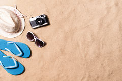 Pair of flip flop sandals, sunglasses, hat and camera. Stock Photography