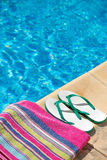 Pair of flip flop thongs and a towel on the side o Stock Image