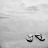 PAIR OF FLIP FLOPS ON CONCRETE GROUND Royalty Free Stock Image