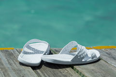 Pair of flip-flops on the pier edge Stock Photography