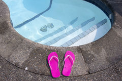 Flip flops at private pool side Stock Photos