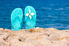 Pair of flip flops in the sand Royalty Free Stock Image