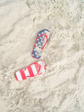 Pair of flip flops on sand beach Stock Photography