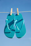 A pair of flipflops against a blue sky Royalty Free Stock Image