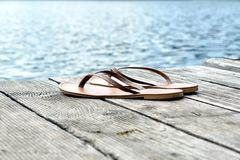 A pair of flipflops near lake. In summer royalty free stock photos