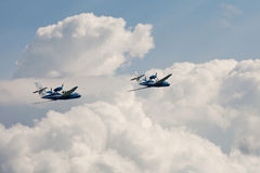 Pair of the  Flying airplane Be-103 in clouds Stock Photography