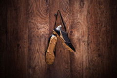 Pair of football boots hanging on a wall Royalty Free Stock Images