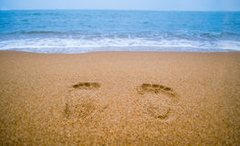 A pair of footprints on the sand Stock Images