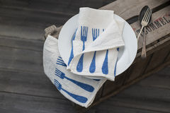 Pair of Fork-Patterned Dinner Napkins with Plate and Old Utensil Royalty Free Stock Photo