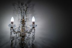 French chandelier on the wall. A pair of french chandelier fixed on a white wall Royalty Free Stock Photography