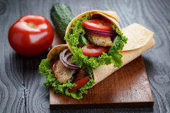 Pair of fresh juicy wrap sandwiches with chicken and vegetables Royalty Free Stock Photos