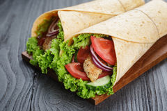 Pair of fresh juicy wrap sandwiches with chicken and vegetables Stock Images