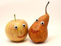 Pair of fruits Apple and PEAR with big eyes Royalty Free Stock Photography