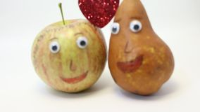 Pair of fruits: Apple and PEAR with big eyes stock video footage