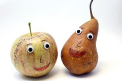 Pair of fruits: Apple and PEAR with big eyes Royalty Free Stock Photo