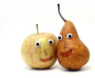 Pair of fruits: Apple and PEAR with big eyes Royalty Free Stock Photography